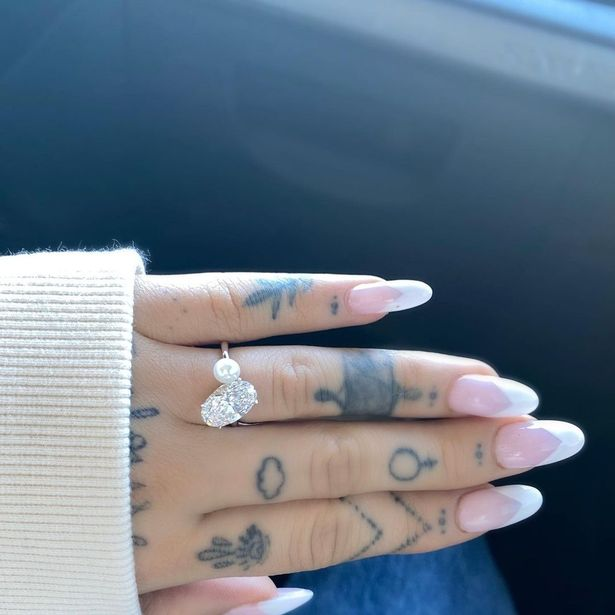 Ariana Grande Diamond and Pearl Engagement Ring Hand Photo
